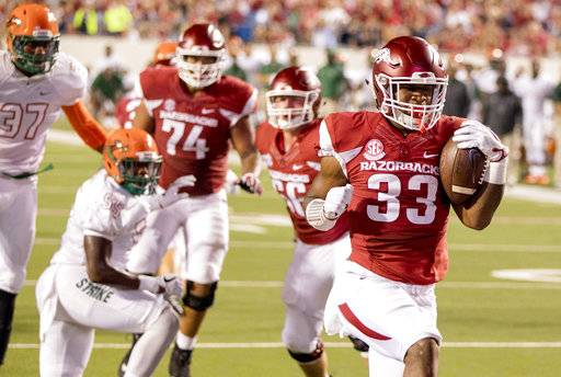 Arkansas running back David Williams, 33, scores a touchdown during the second quarter of an NCAA college football game against Florida A&M on Thursday, Aug. 31, 2017, in Little Rock, Ark.. (AP Photo/Gareth Patterson)