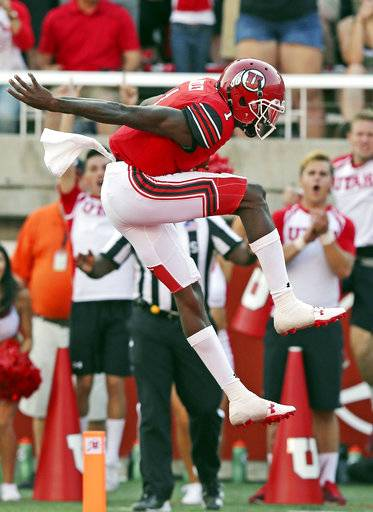 Utah quarterback Tyler Huntley (1) leaps as he scores against North Dakota in the first half during an NCAA college football game Thursday, Aug. 31, 2017, in Salt Lake City, Utah. (AP Photo/Rick Bowmer)