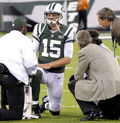 Trainers check on New York Jets quarterback Josh McCown (15) after he took a hard hit from the Philadelphia Eagles during the first half of an NFL football game, Thursday, Aug. 31, 2017, in East Rutherford, N.J. (AP Photo/Bill Kostroun)