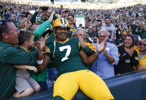 Green Bay Packers' Brett Hundley celebrates his touchdown run with fans during the first half of a preseason NFL football game against the Los Angeles Rams Thursday, Aug. 31, 2017, in Green Bay, Wis. (AP Photo/Matt Ludtke)