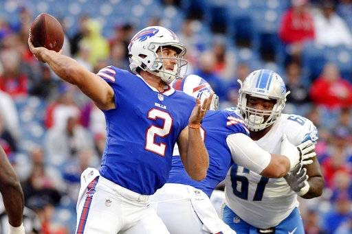 Buffalo Bills quarterback Nathan Peterman (2) throws a pass as Detroit Lions Ego Ferguson rushes him during the first half of a preseason NFL football game Thursday, Aug. 31, 2017, in Orchard Park, N.Y. (AP Photo/Adrian Kraus)