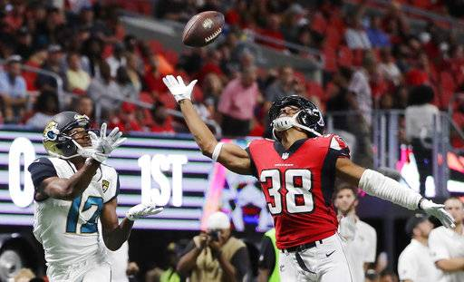 Jacksonville Jaguars wide receiver Dede Westbrook (12) prepares to make a touchdown catch against Atlanta Falcons Akeem King (38) during the first half of an NFL football game, Thursday, Aug. 31, 2017, in Atlanta. (AP Photo/David Goldman)