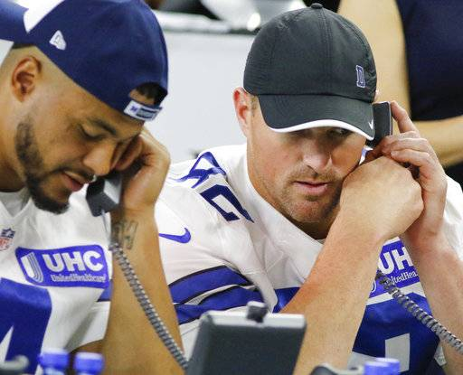 Dallas Cowboys Dak Prescott, left, and Jason Witten, right, were among the players who participated at The Salvation Army telethon at AT&T Stadium in Arlington, Texas Thursday, Aug. 31, 2017. (Ron Baselice/The Dallas Morning News via AP)