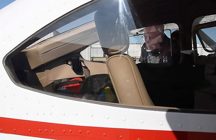Capt. Dave Hooper surveys the four-seat Cessna 182 that he and two other Civil Air Patrol members took from Lake in the Hills Airport Friday for a flight to Texas.