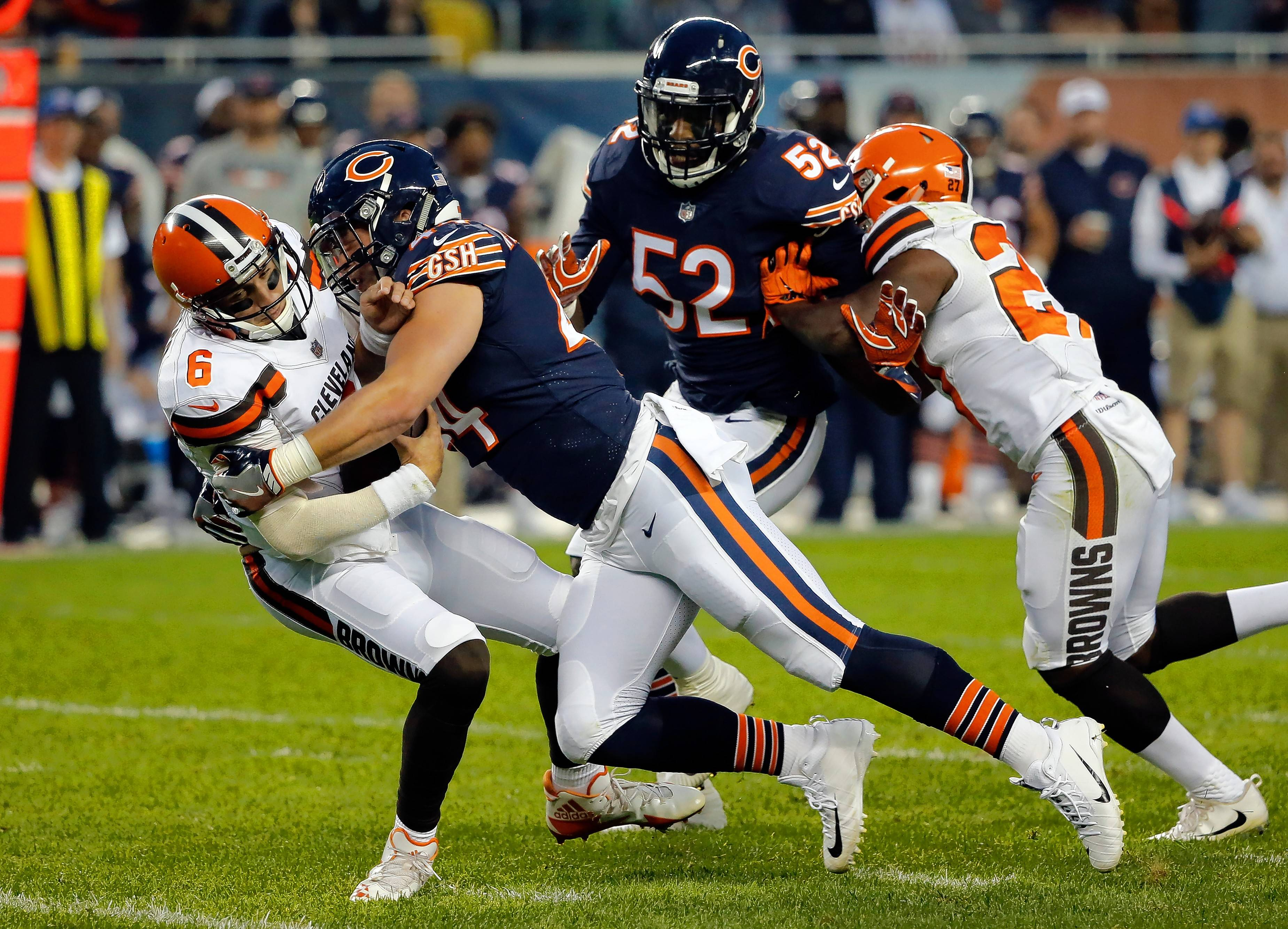 Chicago Bears inside linebacker Nick Kwiatkoski (44) sacks Cleveland Browns quarterback Cody Kessler (6) during the first half of an NFL football game, Thursday, Aug. 31, 2017, in Chicago.