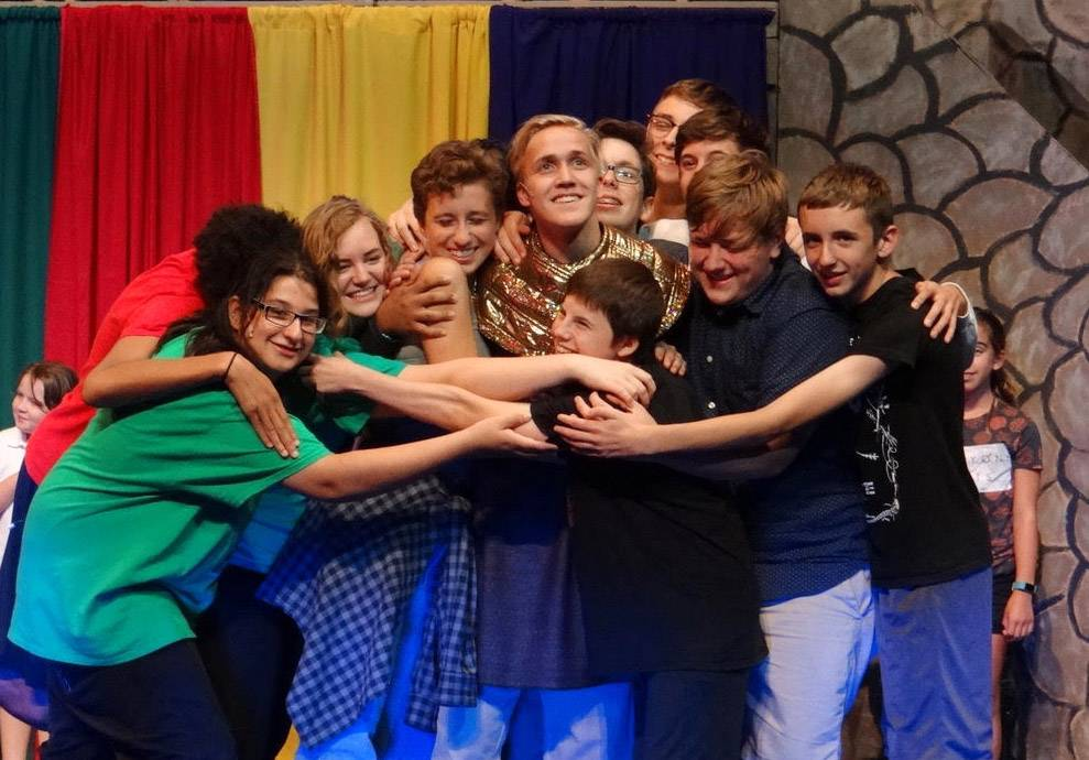 Chase Nelson (center, as Joseph) is surrounded by his brothers. Brothers left to right: Russell Levin, Kendall Burns, Samantha Swartz, Morgan Miller, Nick Geocaris, Mack Day, Lucas Becker, Jake Nyborg, Dominic Frugoli, and John Arnold.