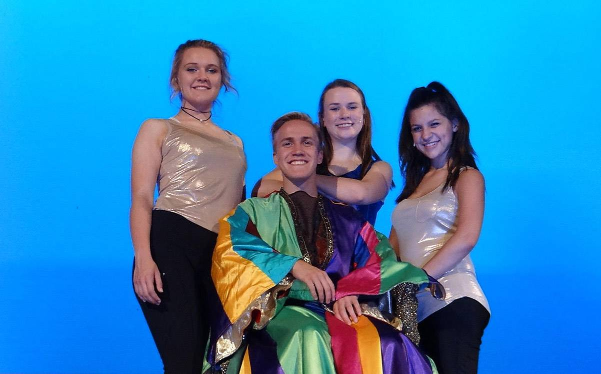 "Chase Nelson as Joseph and narrators, Allison Masulis, left, Sydney Olson and Jessica Farfan from the Fox Valley Theatre Company production of ""Joseph and the Amazing Technicolor Dreamcoat,"" which opens Sept. 8."