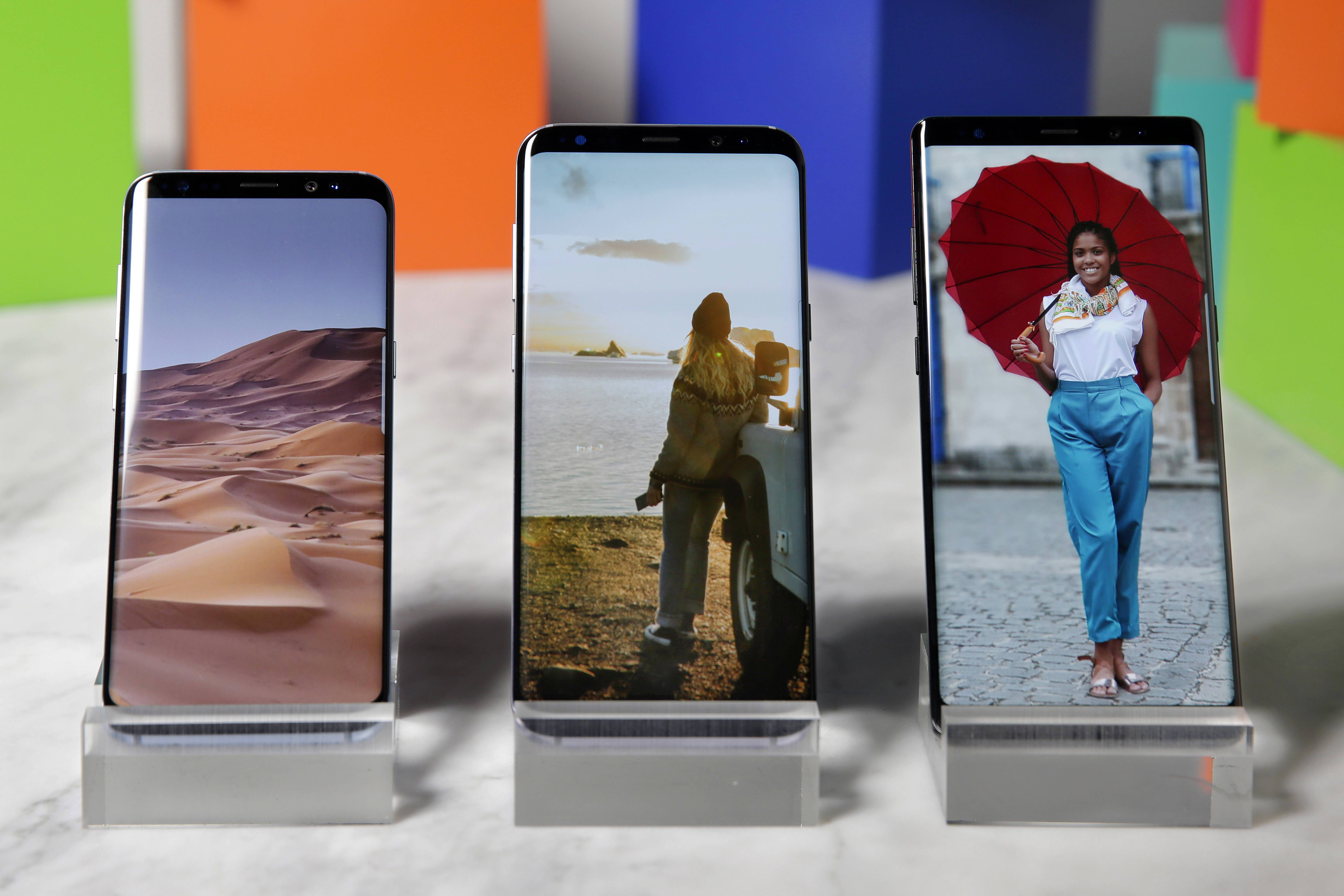 The Samsung Galaxy S8, left, a Samsung Galaxy S8 Plus, center, and Samsung Galaxy Note 8, right. The Note 8, Samsung's latest premium smartphone, starts at $940.