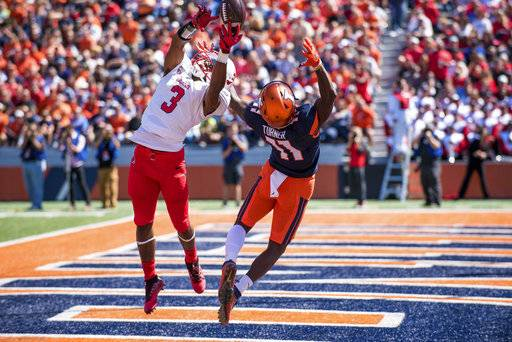 Ball State defensive back Josh Miller (3) breaks up a pass intended for Illinois wide receiver Malik Turner (11) during the second quarter of an NCAA college football game Saturday, Sept. 2, 2017, at Memorial Stadium in Champaign, Ill. (AP Photo/Bradley Leeb)