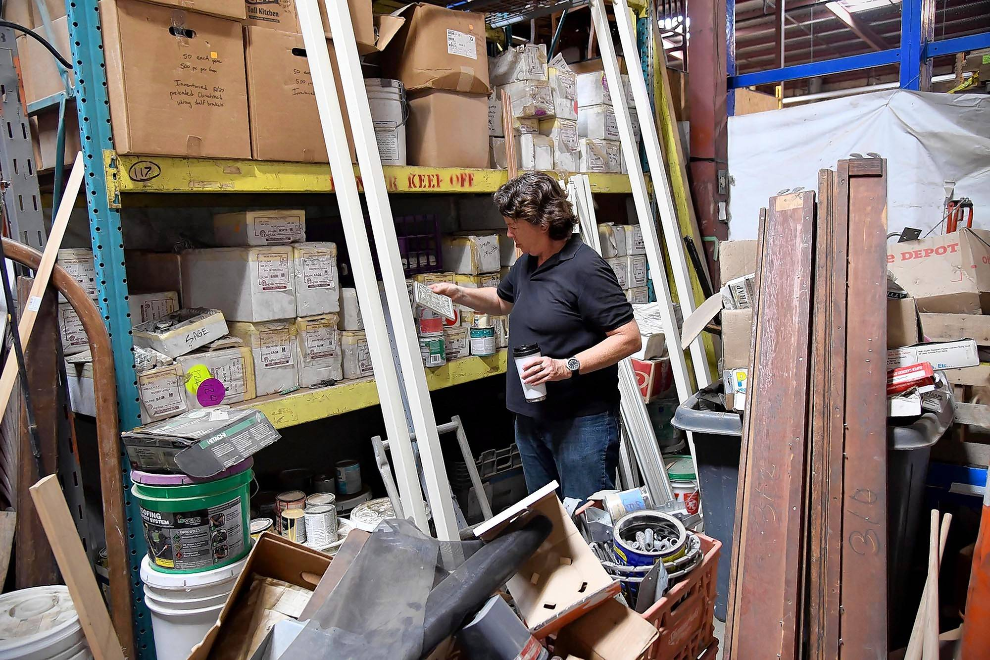 Nancy Meyer finds boxes of expensive Italian tile on a shelf at Community Forklift.
