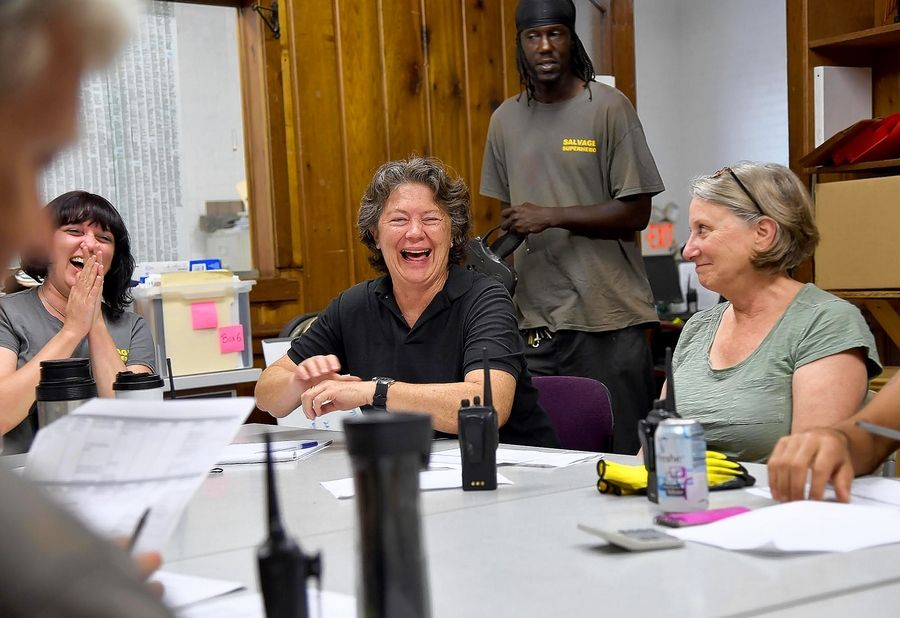 Nancy Meyer, center, tries to create a collaborative workplace where employees work together to solve problems. During a weekly morning meeting, Meyer laughs with Chris Valendez, from left, and Melissa Cooperson.