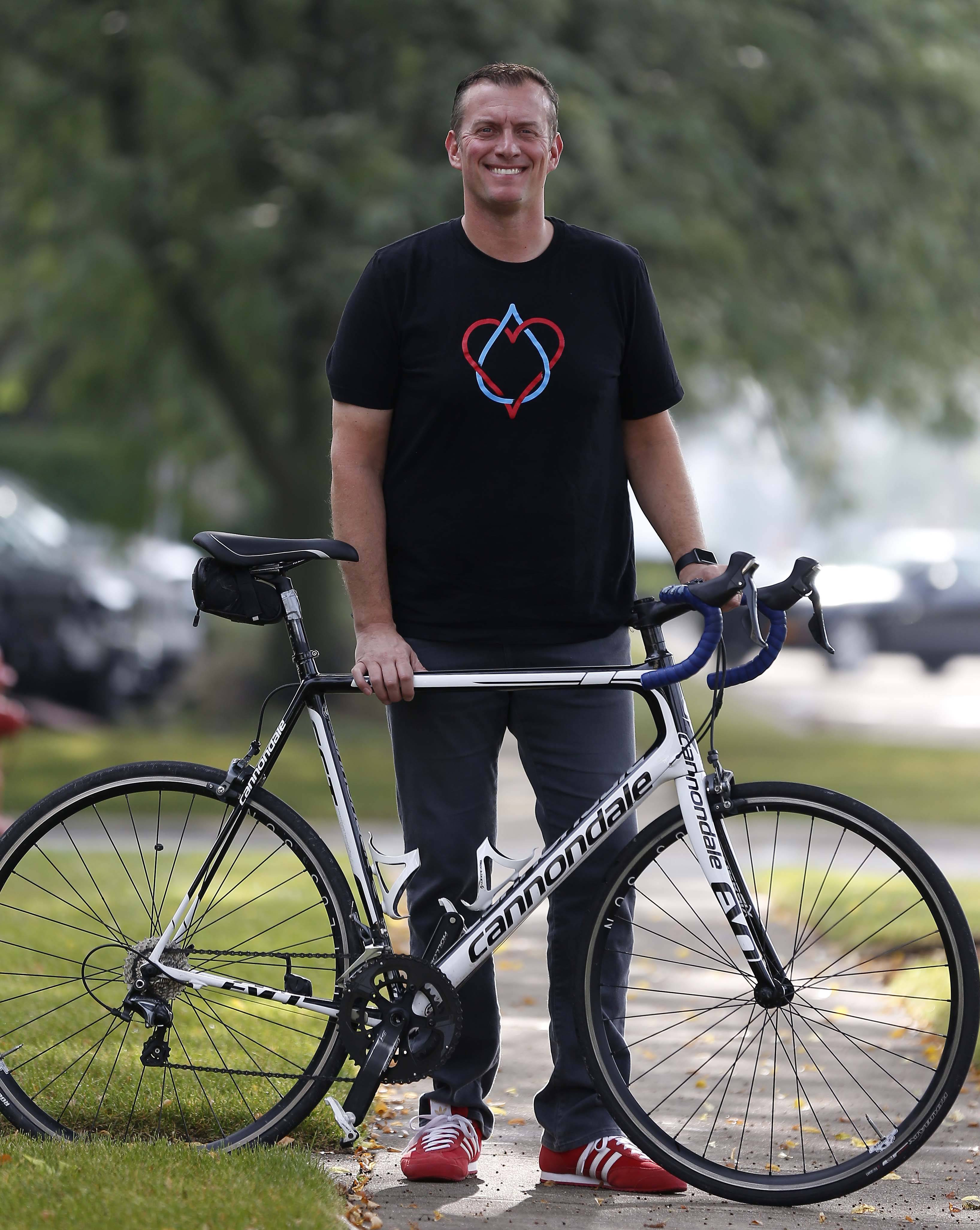 "Justin Ahrens of Geneva will go on a cross-country bike ride starting Sept. 10 to raise money for safe water supplies and sanitation in Uganda, in the ""Wheels 4 Water"" campaign."