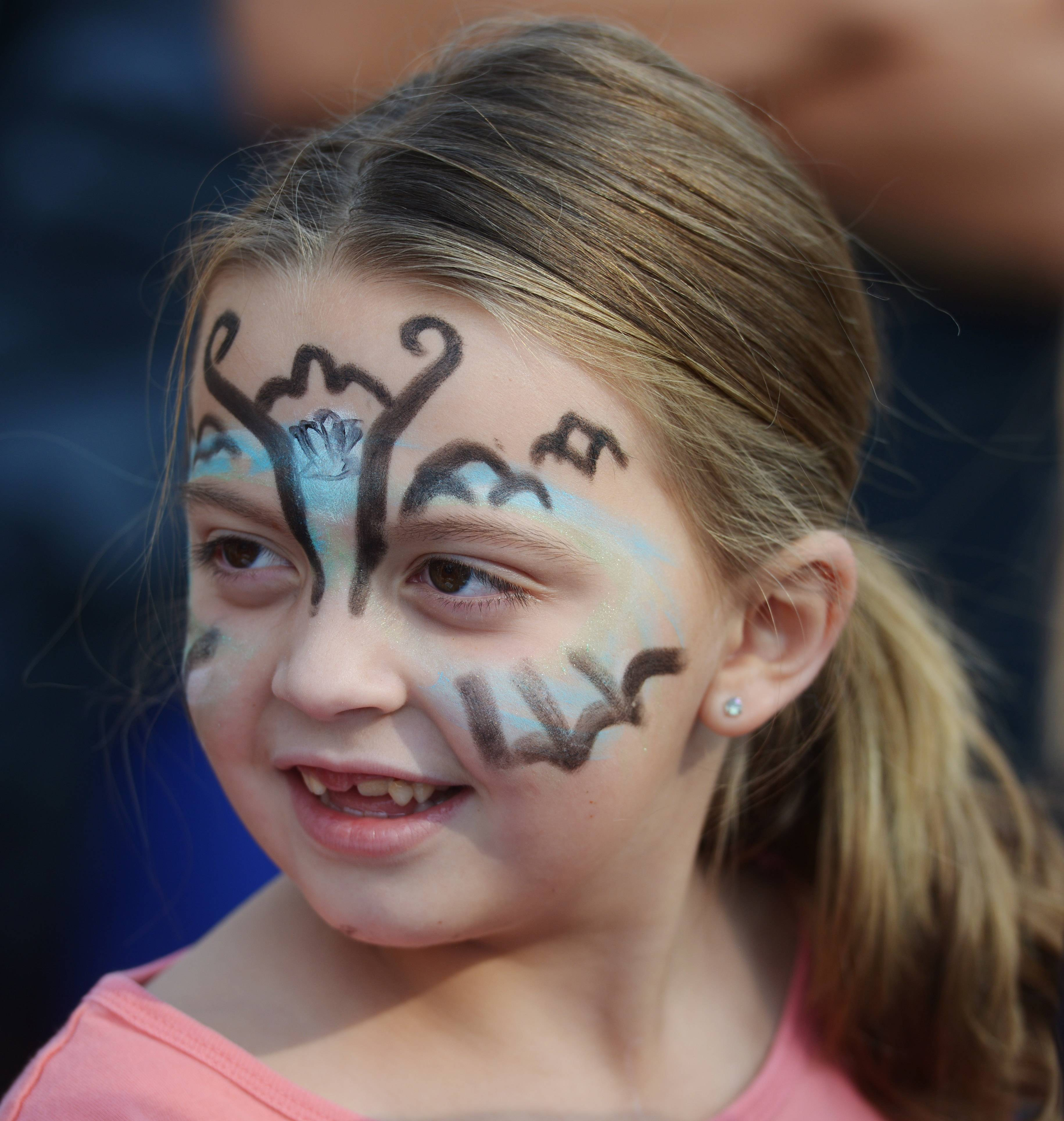 Lucy Cordell, 7, of Wauconda gets her face painted Saturday during the 18th annual Wauconda Street Dance. The event included two stages of entertainment, food, music and more.