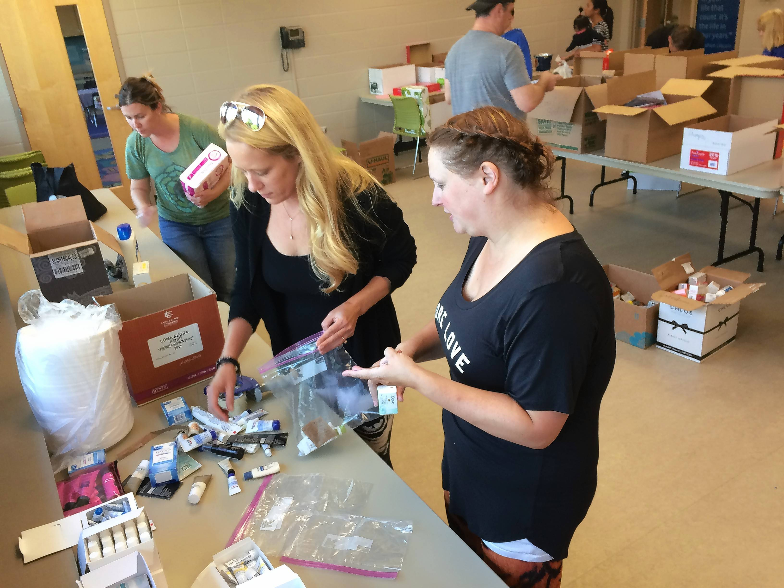 Kristen Klawitter, left, and Karen Gonzales lead Girl Scout Troop 40842 from Patton Elementary School in Arlington Heights. They sorted through donations for Hurricane Harvey victims in Texas on Saturday at Camelot Park Community Center in Arlington Heights. The women were scheduled to begin driving a truck load of donations to Texas in the afternoon.