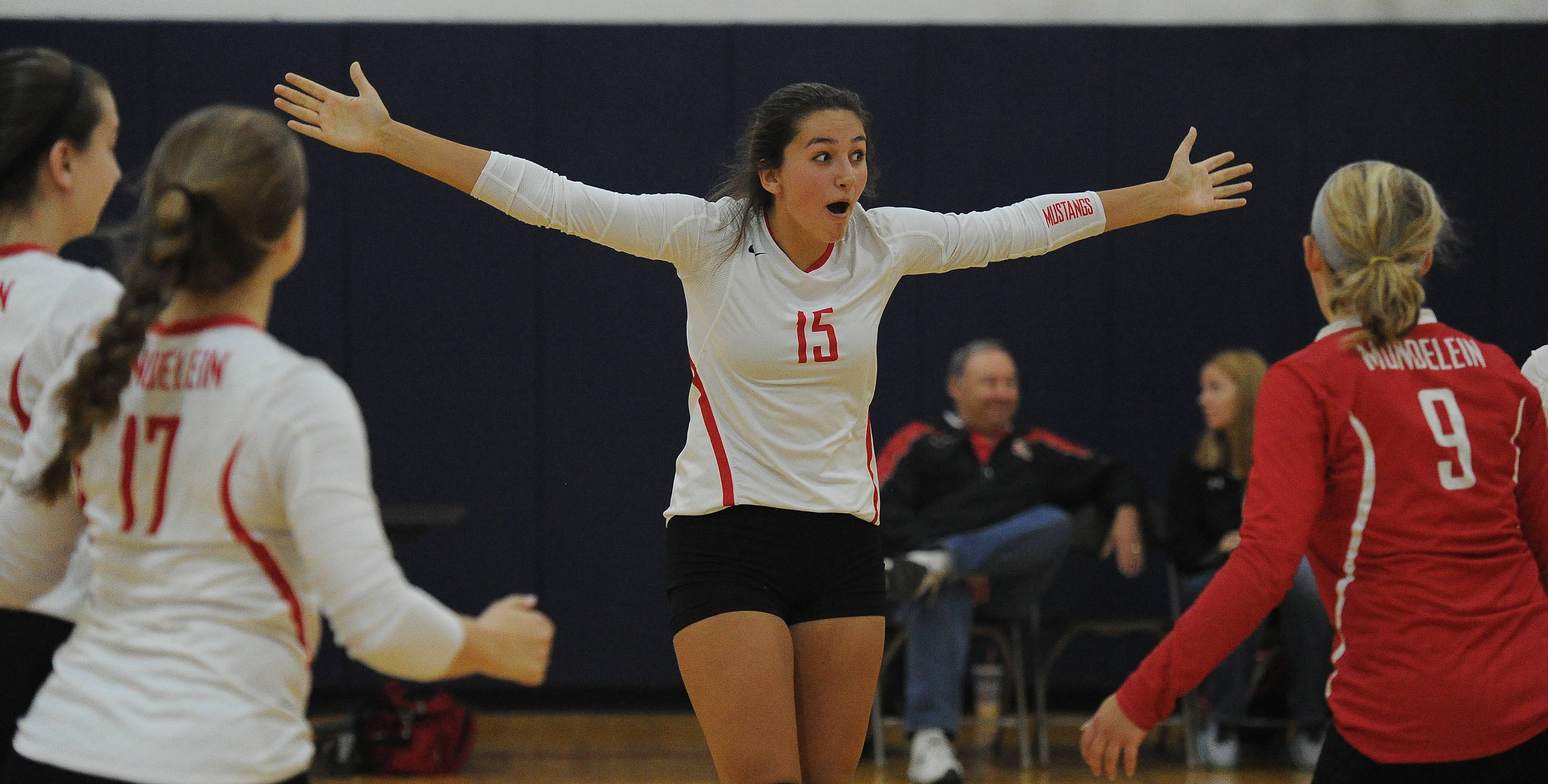 Mundelein's Faith Krabbe celebrates after a victory against Schaumburg in the Peggy Scholten Volleyball Classic on Saturday at Conant.