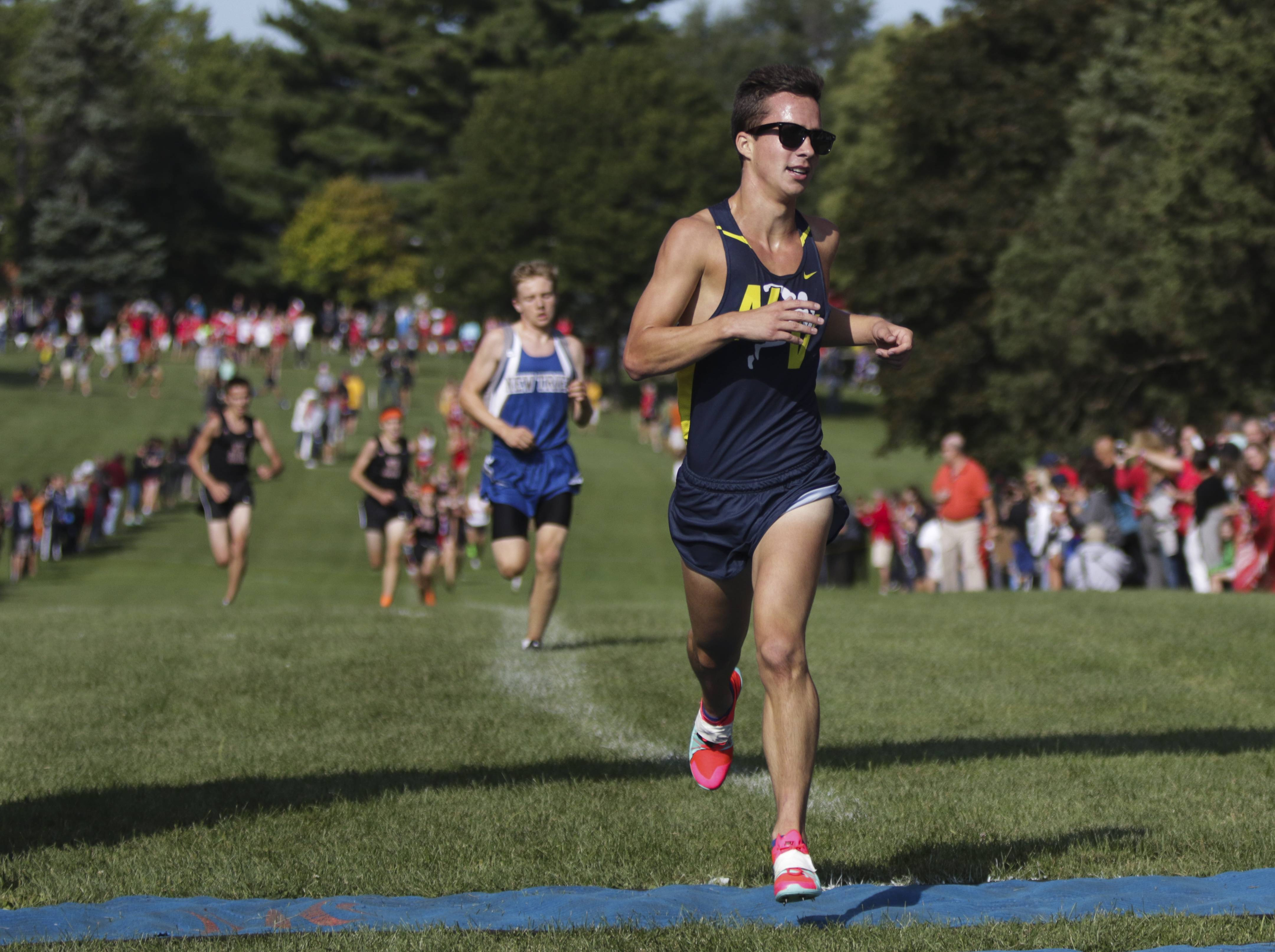 Ryan Kennedy of Neuqua Valley makes his way to a second place finish in the Hinsdale Central/Hinsdale South cross country invitational on Saturday.