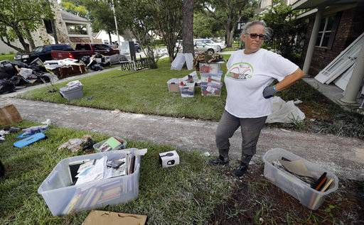 Barron Lazano looks over the damaged to her home and property in the aftermath of Harvey Wednesday, Aug. 30, 2017, in Houston. Harvey did not discriminate in its destruction. It raged through neighborhoods rich and poor, black and white, upscale and working class. Across Houston and surrounding communities, no group sidestepped its paralyzing deluges and apocalyptic floods.(AP Photo/David J. Phillip)