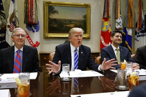 FILE - In this March 1, 2017, file photo President Donald Trump, flanked by Senate Majority Leader Mitch McConnell of Ky., left, and House Speaker Paul Ryan of Wis., speaks in the Roosevelt Room of the White House in Washington. After a summer of staff shake-ups and self-made crises, President Donald Trump is emerging politically damaged, personally agitated and continuing to buck at the confines of his office, according to some of his close allies. (AP Photo/Evan Vucci, File)