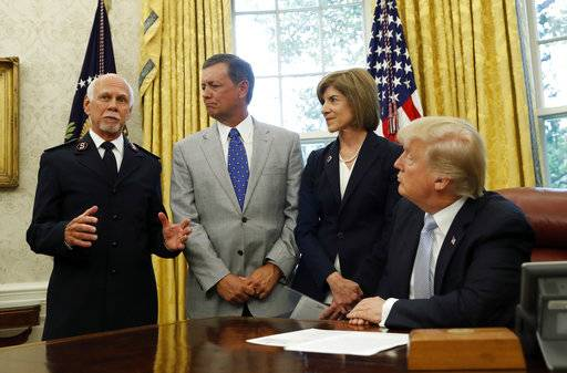 President Donald Trump addresses Commissioner David Hudson, National Commander, Salvation Army USA, left, Kevin Ezell, President of Southern Baptist Disaster Relief, American Red Cross CEO Gail McGovern, in the Oval Office of the White House, Friday, Sept. 1, 2017, in Washington. (AP Photo/Alex Brandon)