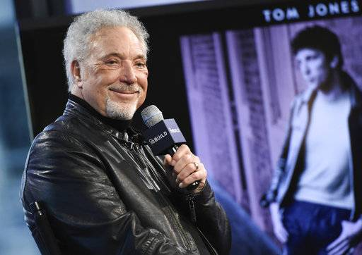 "FILE - In this Dec. 16, 2015 file photo, singer Tom Jones participates in AOL's BUILD Speaker Series to discuss his new album, ""Long Lost Suitcase"", at AOL Studios in New York. Jones has postponed his planned U.S. tour because of health issues. He said on Twitter Saturday, Sept. 2, 2017, that his fall tour will be delayed ""following medical advice,"" without providing further details about why the decision was made. The 77-year-old singer had been expected to begin a lengthy U.S. tour in Pennsylvania on Sept. 6. (Photo by Evan Agostini/Invision/AP)"