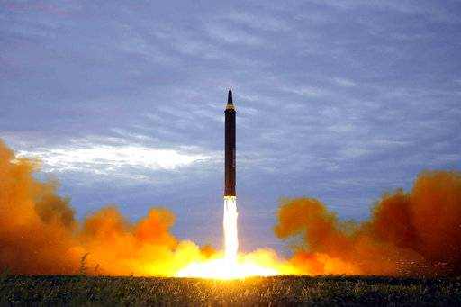 FILE - This Aug. 29, 2017 file photo distributed on Aug. 30, 2017, by the North Korean government shows what was said to be the test launch of a Hwasong-12 intermediate range missile in Pyongyang, North Korea. Japan is debating whether to develop limited pre-emptive strike capability and buy cruise missiles - ideas that were anathema in the pacifist country before the North Korea missile threat. North Korea's test-firing of a missile on Aug. 29, 2017, which flew over Japan and landed in the northern Pacific Ocean, quickly reactivated the debate at parliament and in the media. (Korean Central News Agency/Korea News Service via AP, File)