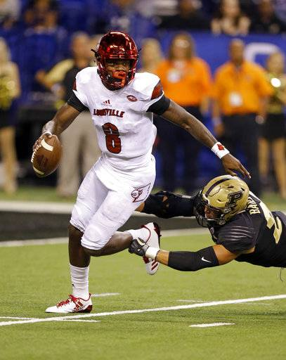 Louisville quarterback Lamar Jackson (8) gets away from Purdue linebacker Markus Bailey (21) during the first half of an NCAA college football game in Indianapolis, Saturday, Sept. 2, 2017. (AP Photo/Michael Conroy)