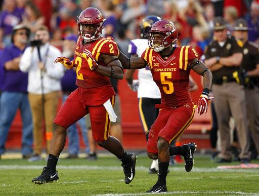 Iowa State linebacker Willie Harvey (2) celebrates with teammate Kamari Cotton-Moya (5) after returning an interception 12-yards for a touchdown during the first half of an NCAA college football game against Northern Iowa, Saturday, Sept. 2, 2017, in Ames, Iowa. (AP Photo/Charlie Neibergall)
