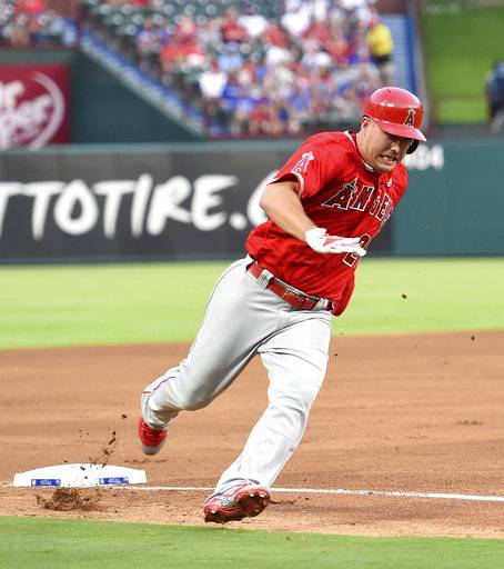 Los Angeles Angels center fielder Mike Trout (27) rounds third on his way to scoring on a single by Albert Pujols in the fourth inning of a baseball game against the Texas Rangers, Saturday, Sept. 2, 2017, in Arlington, Texas. (AP Photo/Jeffrey McWhorter)