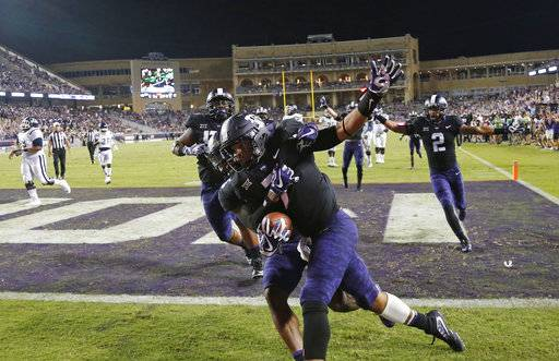 TCU linebacker Arico Evans (7) celebrates his 32-yard touchdown on a fumble recover against Jackson State during the second half of an NCAA college football game in Fort Worth, Texas, Saturday, Sept. 2, 2017. (Rodger Mallison/Star-Telegram via AP)