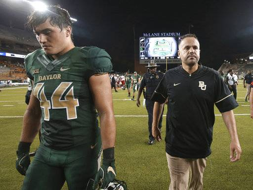 Baylor head coach Matt Rhule, right, walks off the field with linebacker Clay Johnston, left, following in the second half of an NCAA college football game, Saturday, Sept. 2, 2017, in Waco, Texas. (Jerry Larson/Waco Tribune Herald via AP)