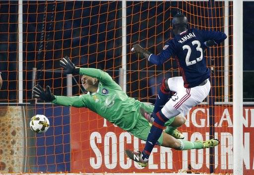 New England Revolution's Kei Kamara (23) scores on Orlando City SC's Joseph Bendik during the first half of an MLS soccer game in Foxborough, Mass., Saturday, Sept. 2, 2017. (AP Photo/Michael Dwyer)
