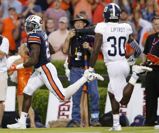 Auburn running back Kerryon Johnson runs into the end zone to score a touchdown in the first half of an NCAA college football game against Georgia Southern, Saturday, Sept. 2, 2017, in Auburn, Ala. (AP Photo/Brynn Anderson)