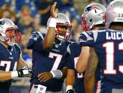 New England Patriots quarterback Jacoby Brissett (7) celebrates with teammates after running for a touchdown against the New York Giants during the second half of an NFL preseason football game, Thursday, Aug. 31, 2017, in Foxborough, Mass. (AP Photo/Winslow Townson)