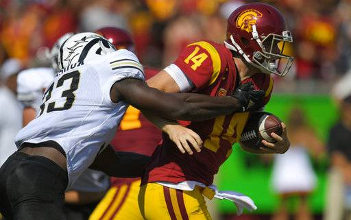 Southern California quarterback Sam Darnold, right, is sacked by Western Michigan defensive lineman Eric Assoua during the first half of an NCAA college football game, Saturday, Sept. 2, 2017, in Los Angeles. (AP Photo/Mark J. Terrill)