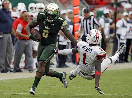 South Florida wide receiver Tyre McCants (8) pushes off Stony Brook defensive back Darin Peart (1) as he pulls in a 65-yard touchdown reception during the fourth quarter of an NCAA college football game Saturday, Sept. 2, 2017, in Tampa, Fla. (AP Photo/Chris O'Meara)