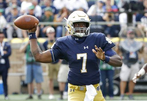Notre Dame quarterback Brandon Wimbush passes during the first half of an NCAA college football game against Temple Saturday, Sept. 2, 2017, in South Bend, Ind. (AP Photo/Charles Rex Arbogast)
