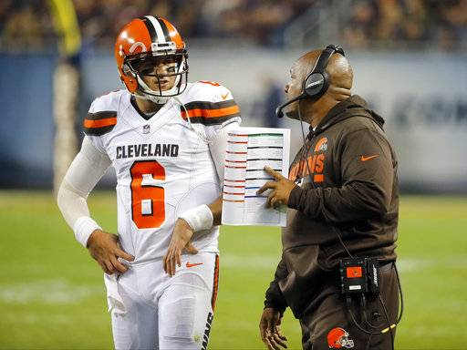 Cleveland Browns quarterback Cody Kessler (6) talks to head coach Hue Jackson during the first half of an NFL football game against the Chicago Bears, Thursday, Aug. 31, 2017, in Chicago. (AP Photo/Charles Rex Arbogast)