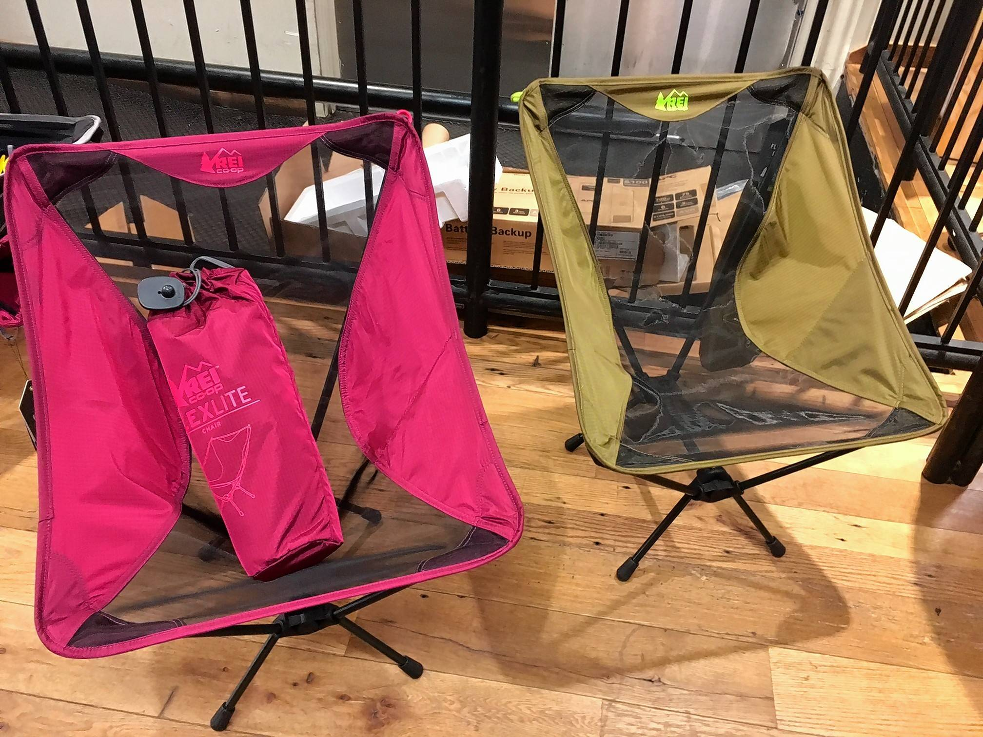 At the REI store in the Soho neighborhood of New York, two Flexlite chairs made by REI are displayed. They come in five different colors and are typical of a genre of compact folding furniture that can also be used indoors.