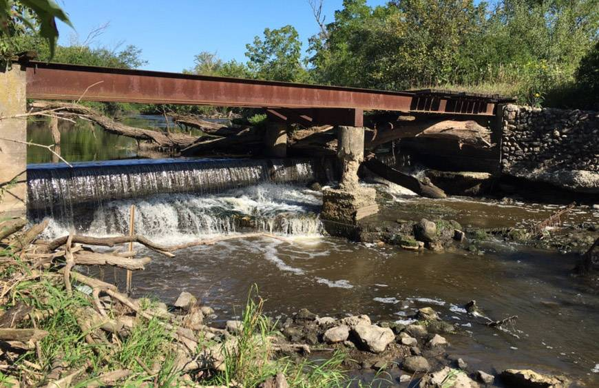 A rusted bridge, deteriorating concrete piers and a small dam that had been underwater will be removed as the next phase of the North Mill Creek restoration project.