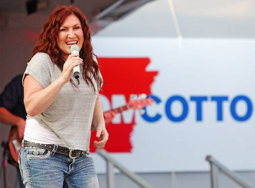 "In this Friday, June 6, 2014, photo, country music singer Jo Dee Messina sings onstage in El Dorado, Ark., during a fundraiser for Rep. Tom Cotton, R-Ark. The country singer, who had hits with songs like ""I'm Alright� and ""Bye Bye,� announced Wednesday, Sept. 6, 2017, that she has cancer and will be postponing her 2017, show dates after Oct. 7, 2017. (Michael Orrell/The El Dorado News-Times via AP, File)"