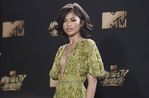 FILE - In this May 7, 2017 file photo, Zendaya arrives at the MTV Movie and TV Awards in Los Angeles. The Gay, Lesbian and Straight Education Network is calling Zendaya a game-changer. The organization known as GLSEN said it will recognize the entertainer with its Gamechanger Award on Oct. 20. (Photo by Richard Shotwell/Invision/AP, File)