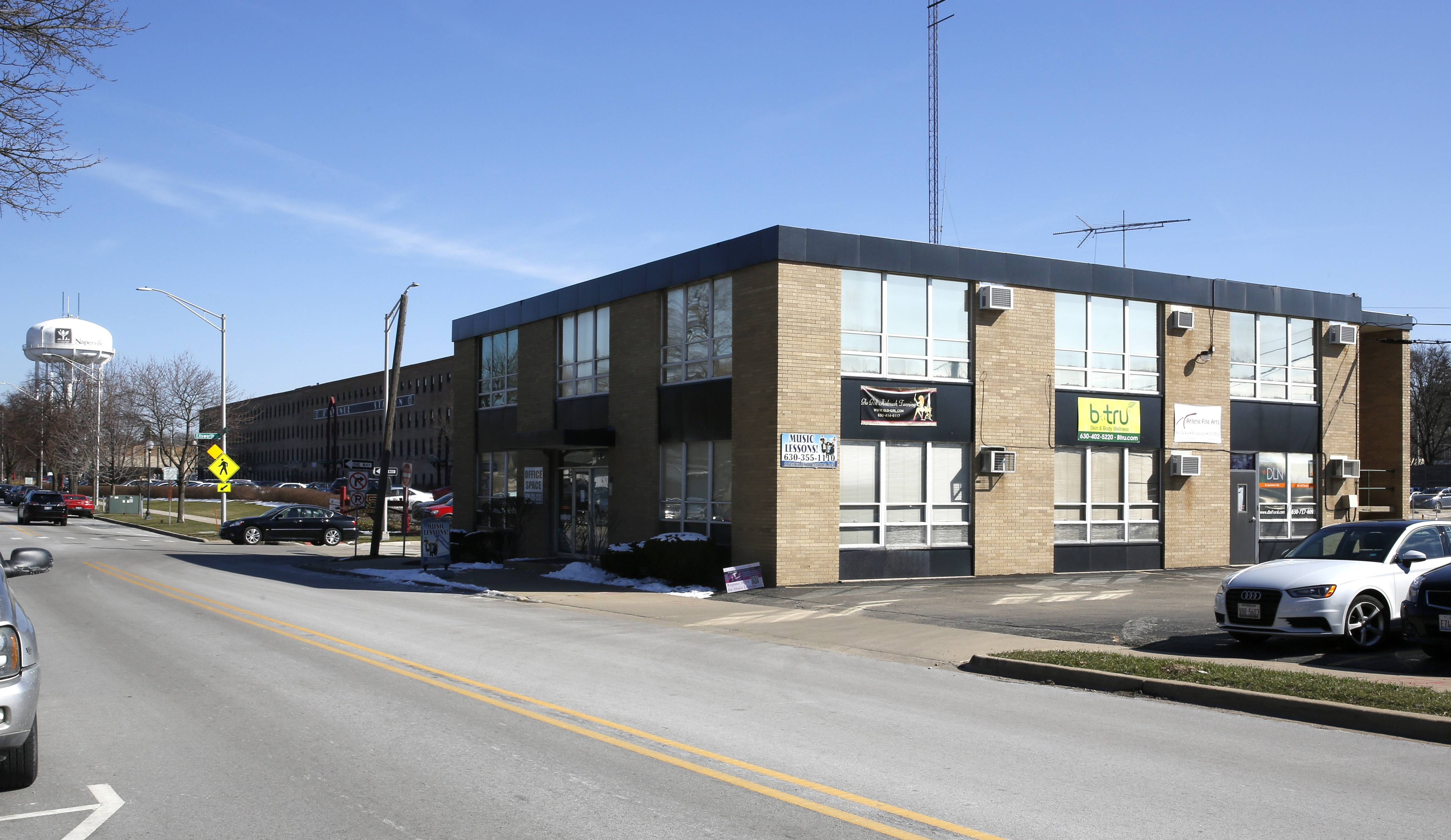 This small business building along 5th Avenue just east of Washington Street in Naperville is one of several city-owned or leased sites totaling 13 acres that could be remade if the city creates a plan and approves a developer to take on the project.