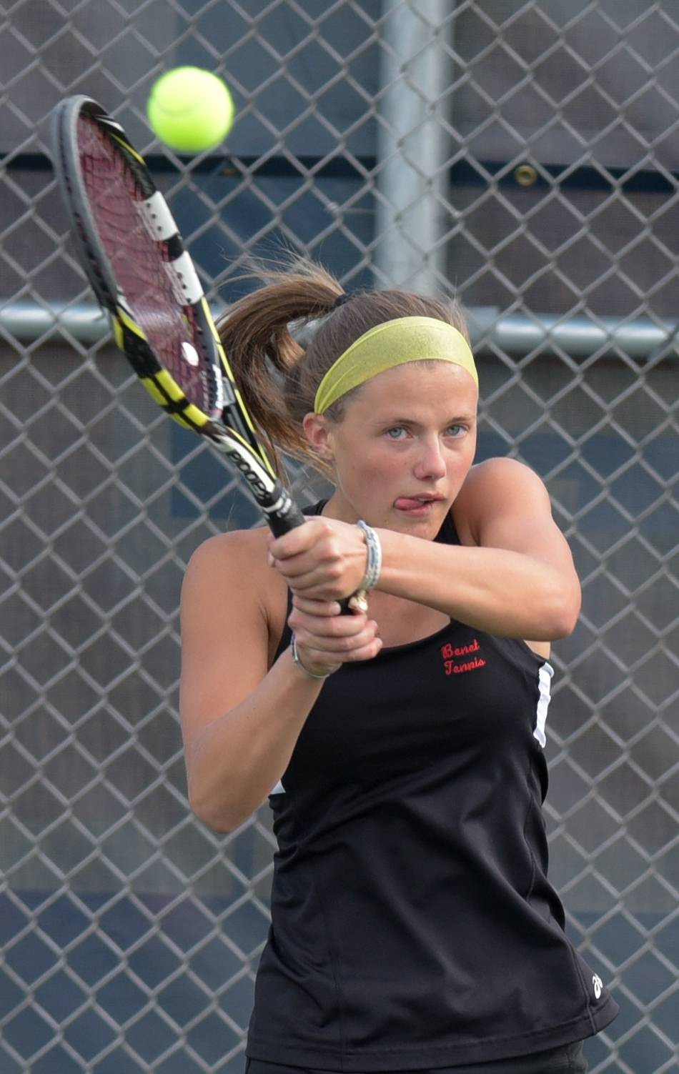 Benet's Caroline Arnold competes against Naperville North's Nyah Woller-Li during varsity girls tennis in Naperville on September 6, 2017.