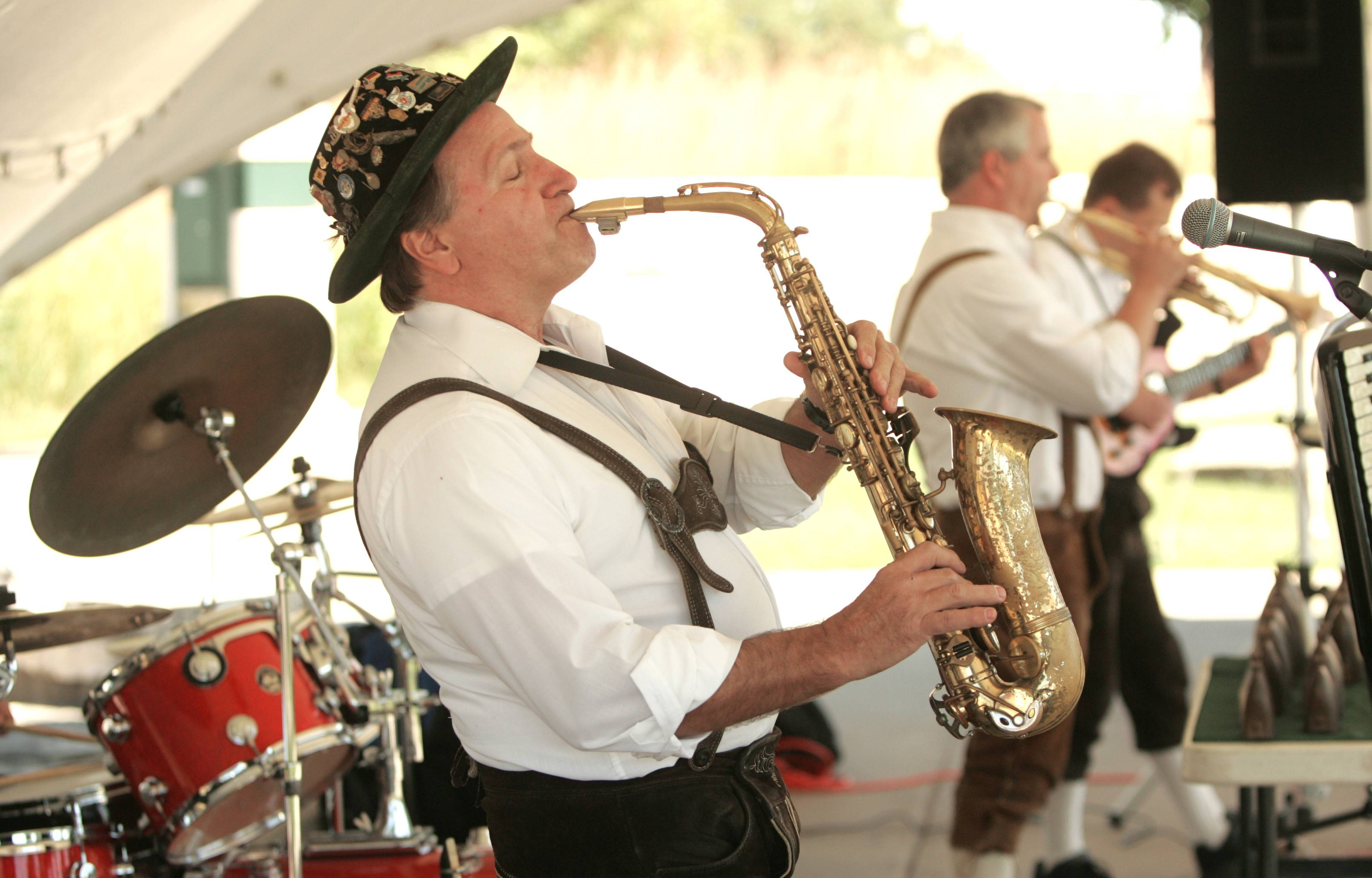 Johnny Wagner plays the saxophone and leads the Johnny Wagner Band during a previous Platzkonzert Germanfest at the Village Green in Hoffman Estates.
