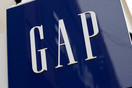 FILE - This Feb. 10, 2017 file photo shows the sign on a Gap store in the Shadyside shopping district of Pittsburgh. Gap Inc. says it will shift its focus to its growing brands Old Navy and Athleta, and away from the Gap and Banana Republic. The company said Wednesday, Sept. 6, that it will close about 200 Gap and Banana Republic stores in the next three years and open about 270 Old Navy and Athleta stores during the same period.(AP Photo/Gene J. Puskar, File)