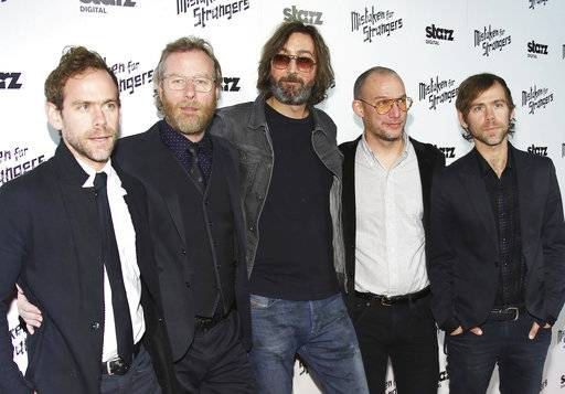"FILE- In this March 25, 2014, file photo, from left, Bryce Dessner, Matt Berninger, Bryan Devendorf, Scott Devendorf, and Aaron Dessner of The National band arrive at the LA Special Screening of ""Mistaken For Strangers"" at the Shrine Auditorium in Los Angeles. With ""Sleep Well Beast,� the band's seventh studio album and first in four years, The National revives the distinctive vibe that led it to the forefront of 21st century arena rock bands. Familiar or not, these guys are good at what they do. (Photo by Annie I. Bang /Invision/AP, File)"