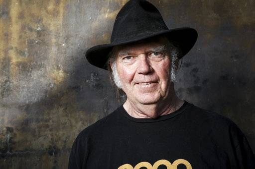 FILE - In this May 18, 2016 file photo, Neil Young poses for a portrait in Calabasas, Calif. Young's lost 1976 acoustic record 'Hitchhiker' uncovers previously unreleased tracks, versions of songs later to become standards. (Photo by Rich Fury/Invision/AP, File)