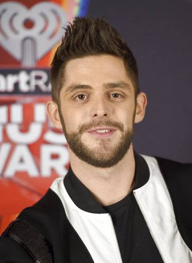 "FILE - In this March 5, 2017 file photo, Thomas Rhett poses in the press room at the iHeartRadio Music Awards in Inglewood, Calif. At 27, country singer Thomas Rhett is enjoying an abundance of blessings and just trying to make sense of it all. The title track of Rhett's new album ""Life Changes� is his bio put to song as he deals with fame, accolades and becoming a father of two girls. (Photo by Jordan Strauss/Invision/AP, File)"