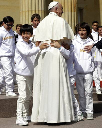 Children embrace Pope Francis during a ceremony at the presidential palace in Bogota, Colombia, Thursday, Sept. 7, 2017. Pope Francis opens the first full day of his Colombia visit on Thursday. (AP Photo/Andrew Medichini)