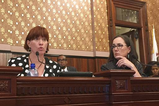 Illinois State Sen. Heather Steans, left, and Rep. Kelly Cassidy, both Chicago Democrats, take testimony over their legislation to legalize general use of marijuana in Illinois at the state Capitol, Wednesday, Sept. 6, 2017, in Springfield, Ill. Law enforcement officers testified that the legislation would cause more problems, particularly with road safety and young people using drugs, but drug policy experts, including former law enforcement officials, said it would be better to legalize and regulate the drug. (AP Photo by John O'Connor)